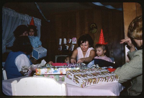 "January 30, 1967 21 Ray Street, Trenton, NJ LEFT TO RIGHT - Mary Alice (Keating) Kuck, Lottie (Krulikowski) Szymanski holding Susan Szymanski, Jon Jay Szymanski, Veronica (Kuck) Szymanski, Maria Jean (Szymanski) Mens and Ann ""Angie"" Szymanski. Maria's birthday party."