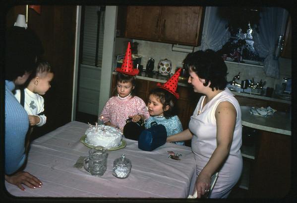 January 30, 1967 21 Ray Street, Trenton, NJ LEFT TO RIGHT - Lottie (Krulikowski) Szymanski holding Jon Jay Szymanski, Maria Jean (Szymanski) Mens, Susan Ann Szymanski, Veronica (Kuck) Szymanski.