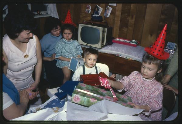 January 30, 1967 21 Ray Street, Trenton, NJ LEFT TO RIGHT - Mary Alice (Keating) Kuck, Veronica (Kuck) Szymanski, Lottie (Krulikowski) Szymanski holding Susan Ann Szymanski, Jon Jay Szymanski and Maria Jean (Szymanski) Mens.
