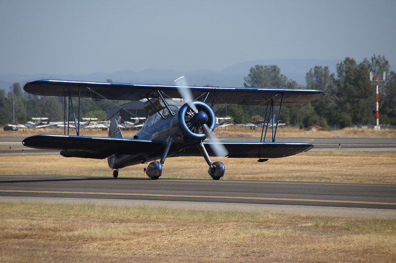 """Super Stearman - Eddie Andreini. <a href=""""http://www.eddieandreiniairshows.com/airshowinfo.html"""">http://www.eddieandreiniairshows.com/airshowinfo.html</a> It would be hard to top the performance put on by this bi-plane. The thing that stood out most in this show was the length of the performances which topped 15 minutes each in many cases."""