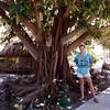 Bora Bora. John Donaldson next to a banyan tree.