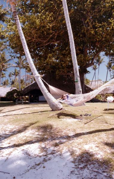 Bora Bora. Nancy in one of the hammocks around the hotel grounds.
