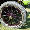The spokes and outer ring are all painted wood.