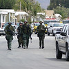 SWAT members came in bunches or singles. Many drove in their private cars, opened their trunks and began to suit up for action. This group is nearing our house on their way to the Command Center.