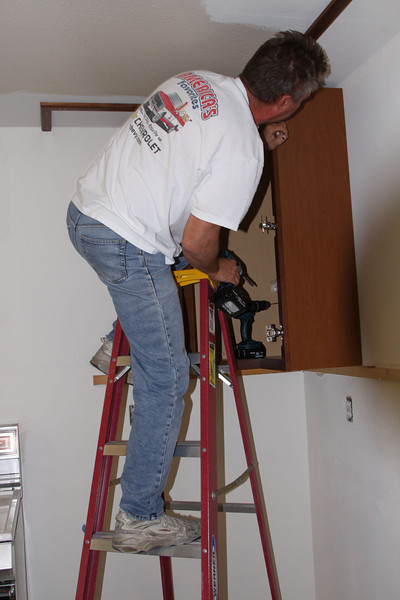 "We are saving almost $4,000. by installing the cabinets ourselves, and by ""ourselves"" I mean Neal, of course."
