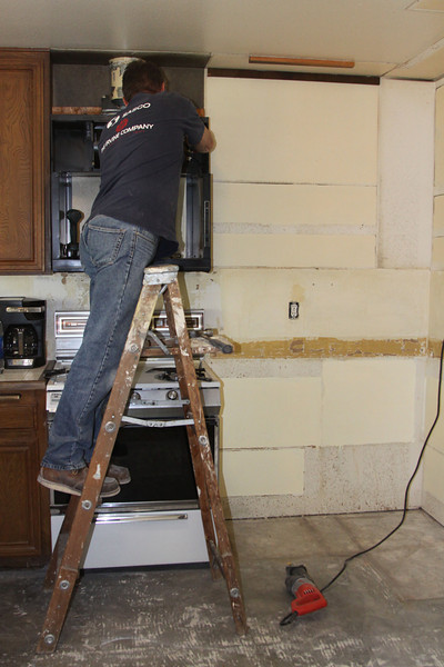 Taking down the vent, cabinet and microwave enclosure over the stove.
