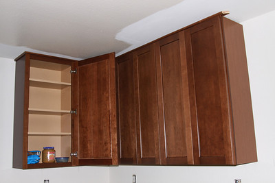 Cherry wood cabinets.