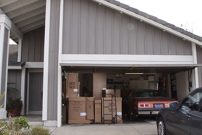 Garage full of boxes. Inside the boxes are all our new cabinets!