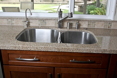 Double stainless steel sink. Controls, from left to right: Insta-hot, faucet, air gap, soap dispenser, garbage disposal air switch.