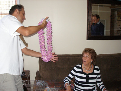 Andy giving Mom her Hawaiian lei