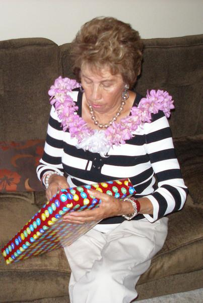 Mom opens her many gifts