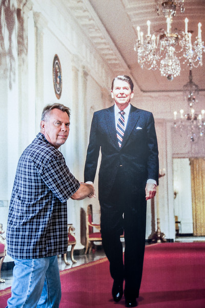 Neal shakes hands with Ronald Regan.
