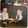 'Lots of instruments for Christmas  Mike is playing the 'ding-ding' (doug's phrase) 1976 2'