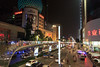 Viewing traffic from overhead walkways in the main shopping area of central Chengdu.