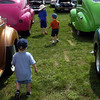 Children investigate at a vintage car show.