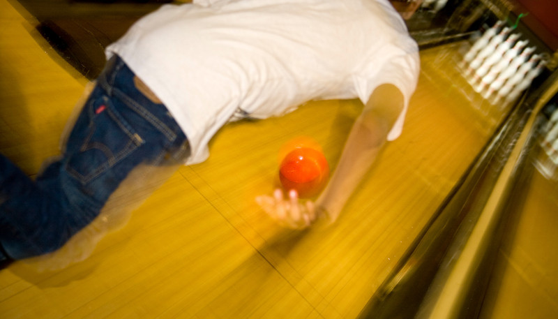 Frozen action while a young man bowls.