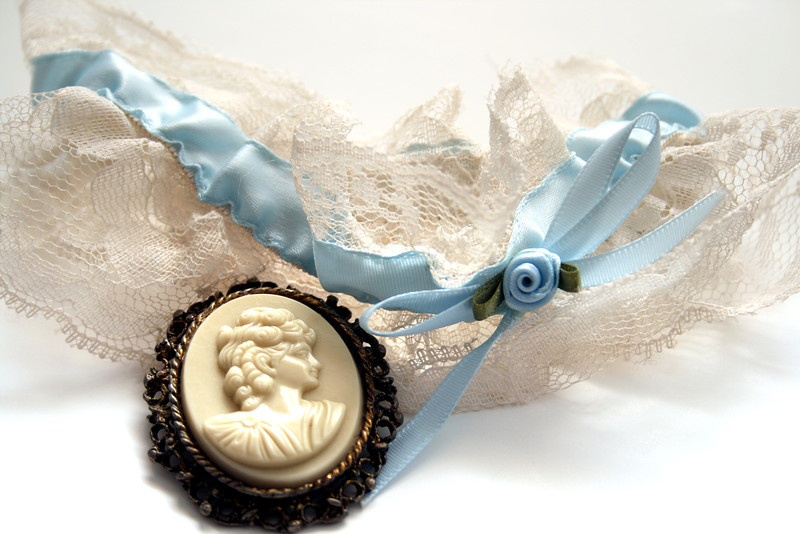 Blue garter and a beautiful antique cameo broach.
