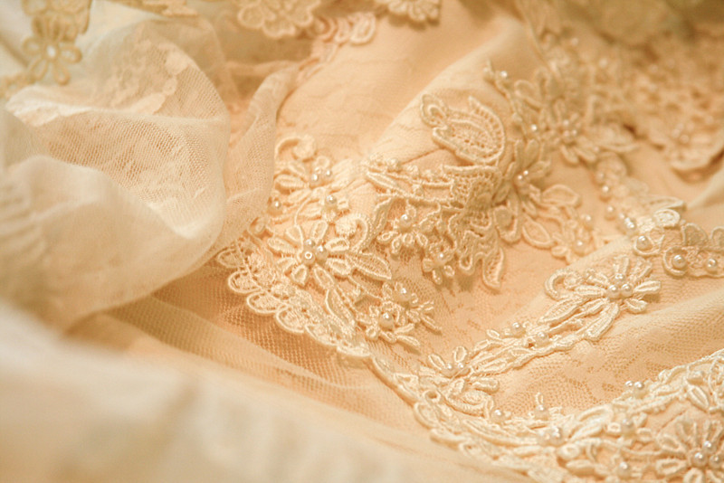 Detail of an ivory lace wedding dress. Vintage 1960 gown.
