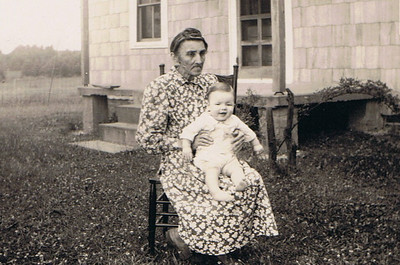 Ethel Rutter holds Bobby Oliver