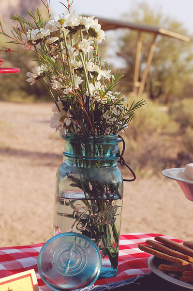 Antique ball jars and simple wildflower-like blooms were simple and fit the theme perfectly.
