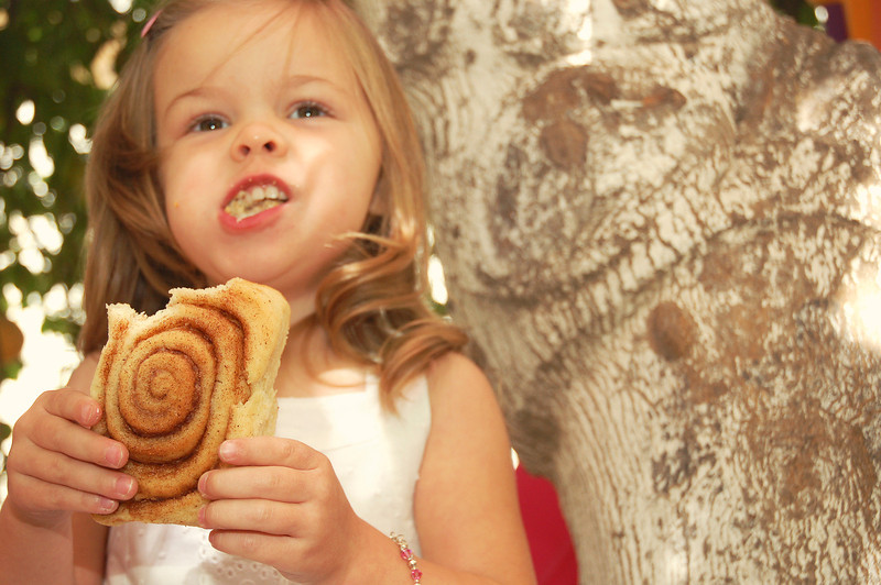 The cinnamon roll was about as big as her head--and she ate it all!