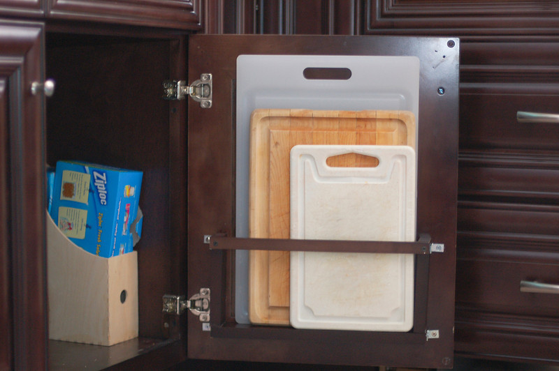 Scraps from my dad's build of the oven cabinet and some hardware I had on hand, and I made myself a behind-the-door vertical cutting board holder!  This is *so* much handier than where we've been storing the cutting boards!