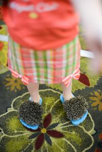 Niamh decided to wear her furry hobbit feet flip flops.