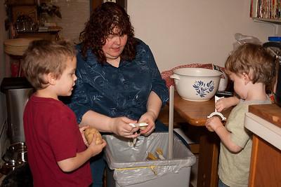Angee gets a bit of help peeling the potatoes.