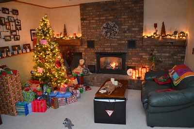 Santa came last night.  Fireplace is heating the basement for the gift exchange.