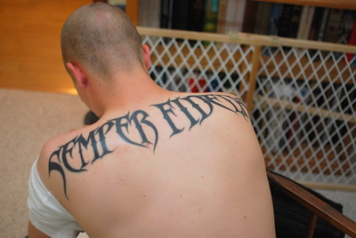 "Chris has a new tatoo. It says Semper Fidelis, which is Latin for ""Always Faithful"""