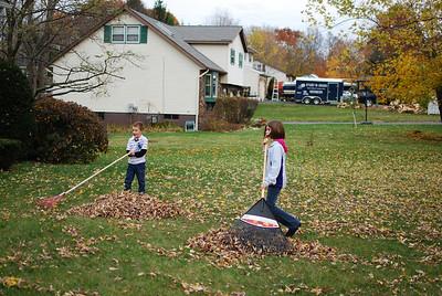 Aiden and Dani raking.