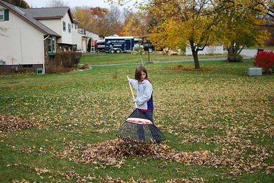 Front yard helpers - Dani raking.