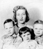 Dorothy Searles Tripp with from right, Russel, Debbie and Neil Tripp. This was their passport photo for the trip to England in 1957 where they lived for 5 years while Ed Tripp was stationed there in the U. S. Air Force.