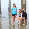 Took the girls to the beach on Friday..  it was super foggy and chilly...  but they got wet anyway...
