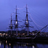 USS Constitution and Bunker Hill Monument at sunset