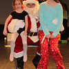 Katie and Jessica visit with Santa after their dance recital.