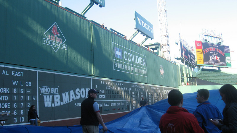 huge tarps are laid down on the field, then the large flag is placed on the tarps