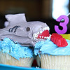 Tiffany is the most creative person!   She made the cool shark cupcakes for Maddie's 3rd birthday.<br /> The shark is a twinkie underneath all that frosting.