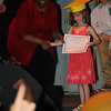 receiving her diploma from Mrs. Davis