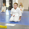 Testing for her Yellow Belt!   Shy smiles upon receiving her certificate and the new belt! :)