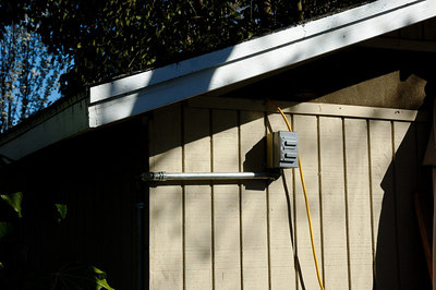 Outlet and conduit on outside of shop
