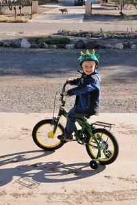 Riding his bike