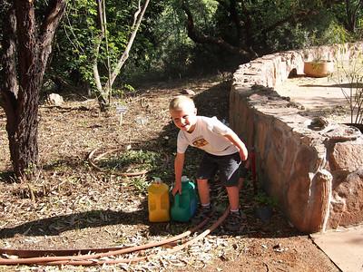 Brandon helping the gardener