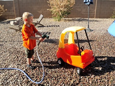 Washing his car