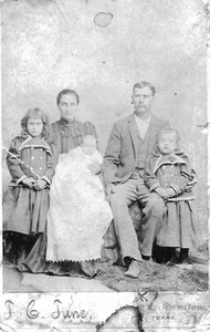 My grandmother Jewell Haire and her parents. Not sure which kid she is.