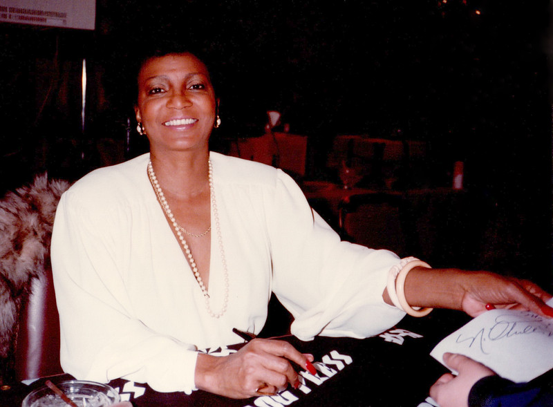 Nichelle signing autographs at a Boston convention