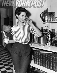 Model and Actress Nancy Berg enjoys a cocktail. 1955