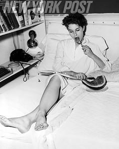Nancy Berg enjoys a watermelon treat. 1955