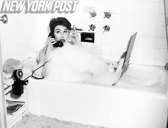 Nancy Berg multitasks in the bathtub. 1955