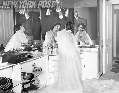 Beautiful model Nancy Berg gets ready for bed. 1955